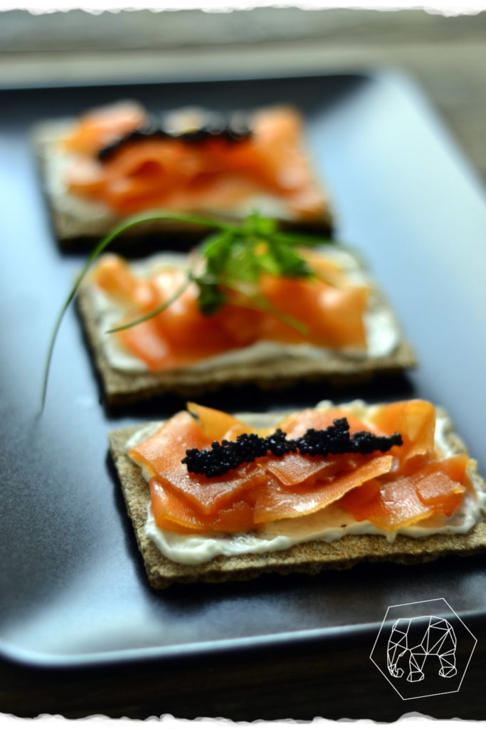 Carrot salmon, vegan cream cheese and caviar made from algae on swedish crispbread