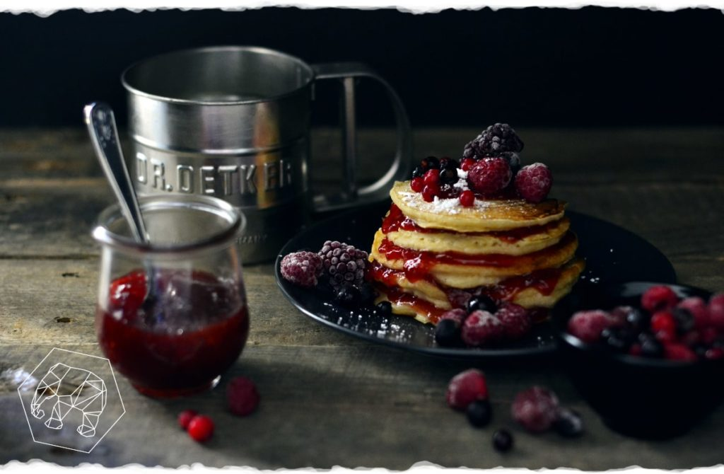American pancakes with jam and forest berries